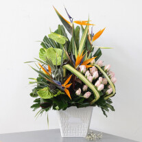 Tropicals anthiriums and roses arrangement