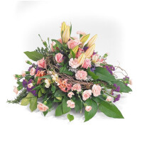 Informal wreath of carnations, statis, lilies, roses, vine and greenery to express your loving thoughts